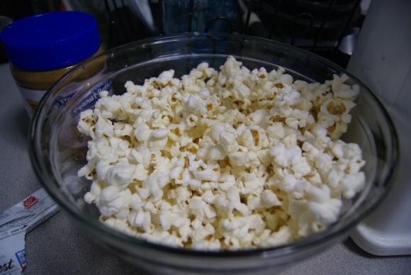 Large glass bowl. Popcorn. Creative captioning.