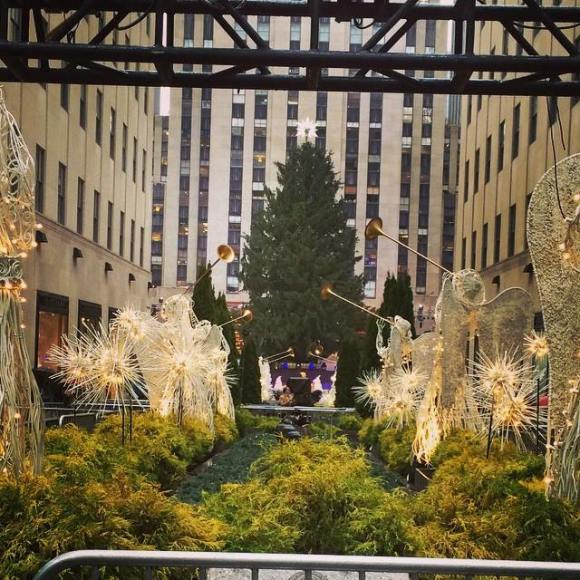 It's the Rockefeller tree, ya'll! Granted, it has yet to be lit and also this picture is from around this time last year but... holiday spirit?